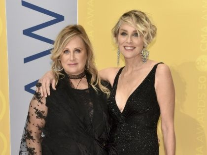 Kelly Stone, left, and Sharon Stone arrive at the 50th annual CMA Awards at the Bridgestone Arena on Wednesday, Nov. 2, 2016, in Nashville, Tenn. (Photo by Evan Agostini/Invision/AP)