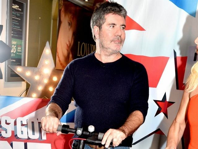 MANCHESTER, ENGLAND - FEBRUARY 06: Simon Cowell and Amanda Holden during the 'Britain's Got Talent' Manchester photocall at The Lowry on February 06, 2019 in Manchester, England. (Photo by Shirlaine Forrest/Getty Images)