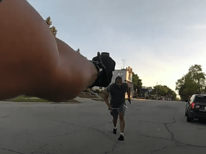 Body cam footage from Sheboygan, Wisconsin, shows 32-year-old Kevan Ruffin, Jr., allegedly armed with knives and charging at police officer Bryan Pray, then getting shot.