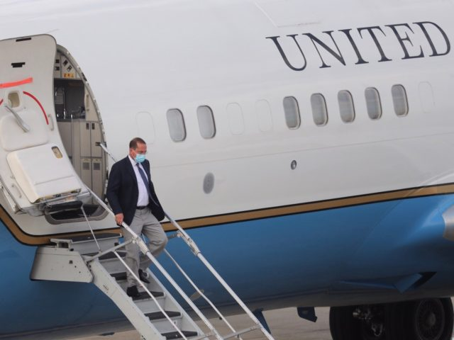 US Health Secretary Alex Azar walks out of a plane as he arrives at the Sungshan Airport in Taipei on August 9, 2020. - Azar, a senior member of US President Donald Trump's administration, landed in Taiwan on August 8, 2020 for Washington's highest level visit since switching diplomatic recognition …