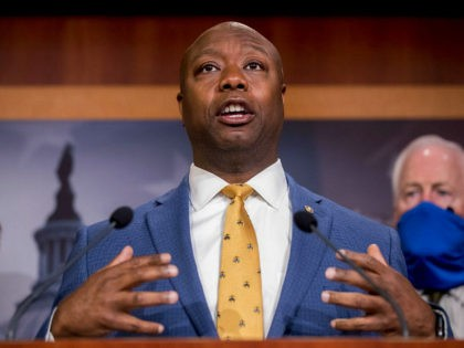 Sen. Tim Scott, R-S.C., accompanied by Republican senators speaks at a news conference to announce a Republican police reform bill on Capitol Hill, Wednesday, June 17, 2020, in Washington. (AP Photo/Andrew Harnik)