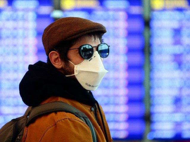 A man wearing a protective mask walks at the Terminal 1 of El Prat airport in Barcelona on March 16, 2020. - After the COVID-19 pandemic began in China late last year, Europe in recent weeks emerged as the biggest flashpoint and the death toll on the continent surged over …