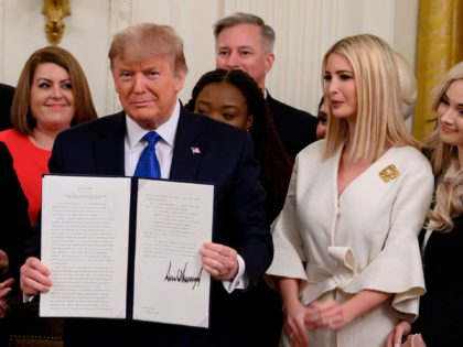 US President Donald holds up an executive order on combating human trafficking next to Ivanka Trump (R) in the East Room of the White House in Washington, DC on January 31, 2020. (Photo by ANDREW CABALLERO-REYNOLDS / AFP) (Photo by ANDREW CABALLERO-REYNOLDS/AFP via Getty Images)