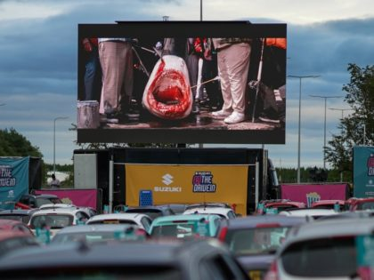 NEWCASTLE UPON TYNE, ENGLAND - AUGUST 05: Cars park up to watch a showing of Jaws during a drive-in cinema experience at Newcastle Airport on August 05, 2020 in Newcastle upon Tyne, England. The venue at Newcastle airport is one of 12 venues around the country that will host the …