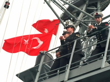 Turkish navy officers stand on the desk of their TCG Yavuz frigate, 05 January, as they arrive at the Haifa harbour, northern Israel. A US and Turkish navy ships arrived in this Meediterranean port to begin joint maneuvers with Israel which have drawn sharp protests from Arab States. (Photo by …