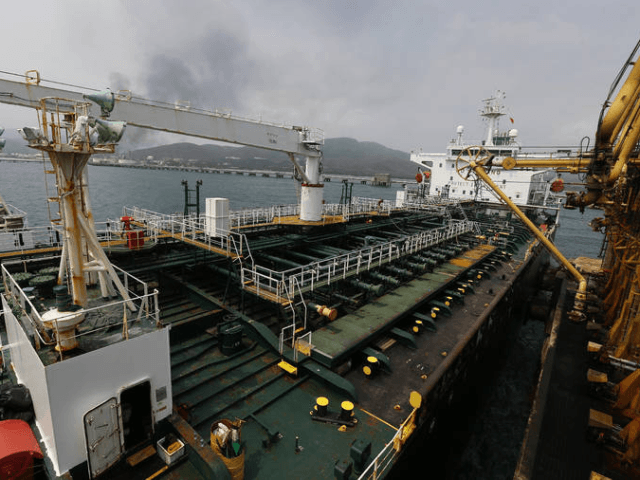 In this May 25, 2020 file photo, the Iranian oil tanker Fortune is anchored at the dock of the El Palito refinery near Puerto Cabello, Venezuela. U.S. officials said Thursday, Aug. 13, 2020, that the Trump administration has seized the cargo of four tankers it was targeting for transporting Iranian …