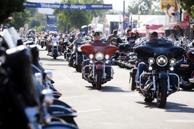 In this Aug. 5, 2016 file photo, bikers ride down Main Street in downtown Sturgis, S.D., before the 76th Sturgis motorcycle rally officially begins. South Dakota, which has seen an uptick in coronavirus infections in recent weeks, is bracing to host hundreds of thousands of bikers for the 80th edition …