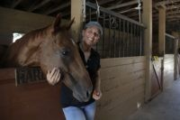 Timea Hunter poses for a photograph at the Family Horse Academy, where she is hoping to organize education for a group of children during the coronavirus pandemic, Friday, July 31, 2020, in Southwest Ranches, Fla. Confronting the likelihood of more distance learning, families across the country are turning to private …