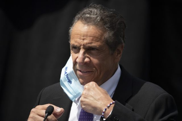 New York Gov. Andrew Cuomo removes a mask as he holds a news conference in a Monday, June 15, 2020 file photo, in Tarrytown, N.Y. New York Gov. Andrew Cuomo takes the reins of the group representing the nation's governors, which has played a pivotal role in communicating with the …