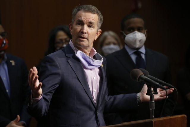 In this June 4, 2020, file photo Virginia Gov. Ralph Northam speaks during a news conference in Richmond, Va. Virginia has rolled out a smartphone app to automatically notify people if they might have been exposed to the coronavirus. It's the first U.S. state to use new pandemic technology created …