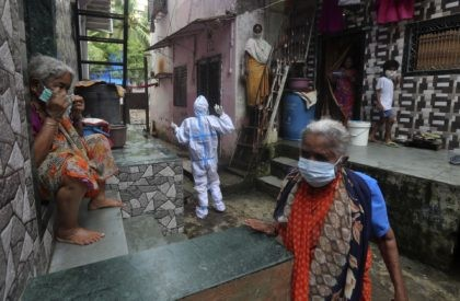 A health worker calls out to people to come out for screening for COVID-19 symptoms in Dharavi, one of Asia's biggest slums, in Mumbai, India, Tuesday, Aug. 11, 2020. India has the third-highest coronavirus caseload in the world after the United States and Brazil. (AP Photo/Rafiq Maqbool)
