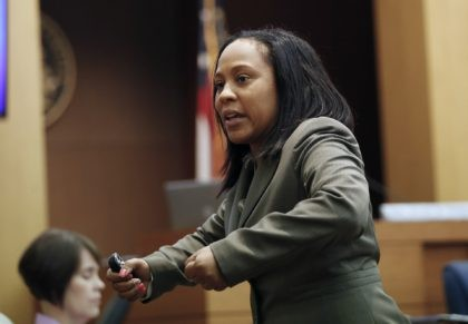 In this Wednesday, Aug. 24, 2016, file photo, Fulton County Deputy District Attorney Fani Willis makes her closing arguments during a trial in Atlanta. Fulton County District Attorney Paul Howard has run unopposed for two decades. But he came in second to his former longtime assistant Willis in the June …