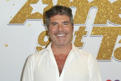 """In this Sept. 18, 2018, file photo, Simon Cowell arrives at the """"America's Got Talent"""" Season 13 Finale Show red carpet at the Dolby Theatre, in Los Angeles. """"America's Got Talent"""" topped the ratings last week, but it faces the absence of Cowell, seriously injured in an electric bicycle accident. …"""