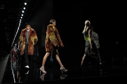 In this Friday, Feb. 21, 2020 file photo, models wear creations as part of Versace Fall/Winter 2020/2021 collection, presented in Milan, Italy. Giorgio Armani, Fendi, Prada and Versace are all returning to the runway in September, according to the Milan Fashion Week calendar published on Wednesday, Aug. 12, 2020. After …