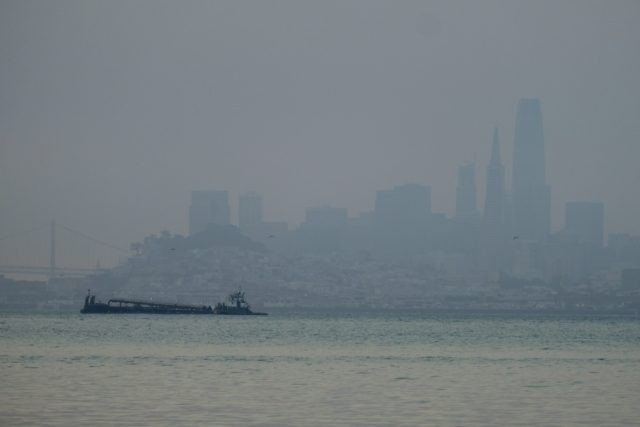 The San Francisco skyline is barely visible through smoke from wildfires Wednesday, Aug. 19, 2020, in this view from Sausalito, Calif. Thousands of people were under orders to evacuate in regions surrounding the San Francisco Bay Area Wednesday as nearly 40 wildfires blazed across the state amid a blistering heat …