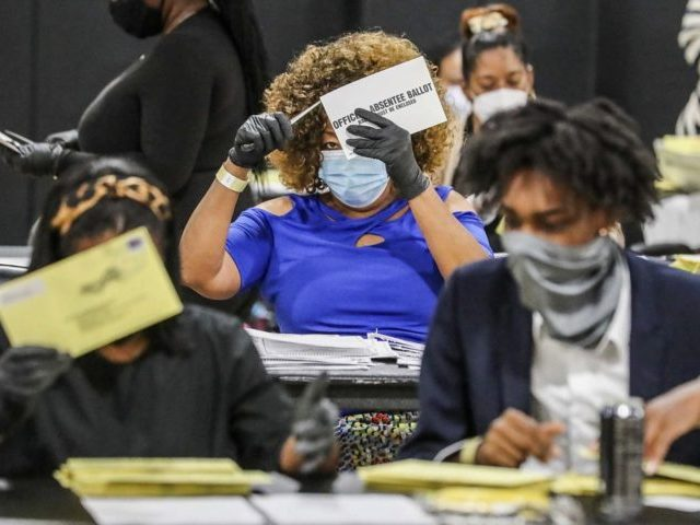 In this Tuesday, Aug. 11, 2020 file photo, election officials sort absentee ballots in Atlanta. U.S. Postal Service warnings that it can't guarantee ballots sent by mail will arrive on time have put a spotlight on the narrow timeframes most states allow to request and return those ballots. (John Spink/Atlanta …