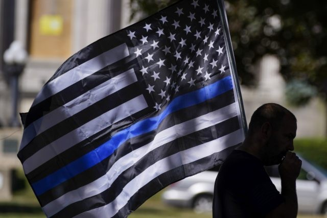 An unidentified man participates in a Blue Lives Matter rally Sunday, Aug. 30, 2020, in Kenosha, Wis. (AP Photo/Morry Gash)