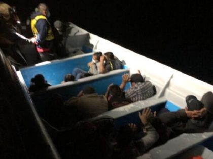 CBP Marine Interdiction vessel crew members apprehend 15 illegal aliens in a boat off the coast of San Diego. (U.S. Customs and Border Protection)