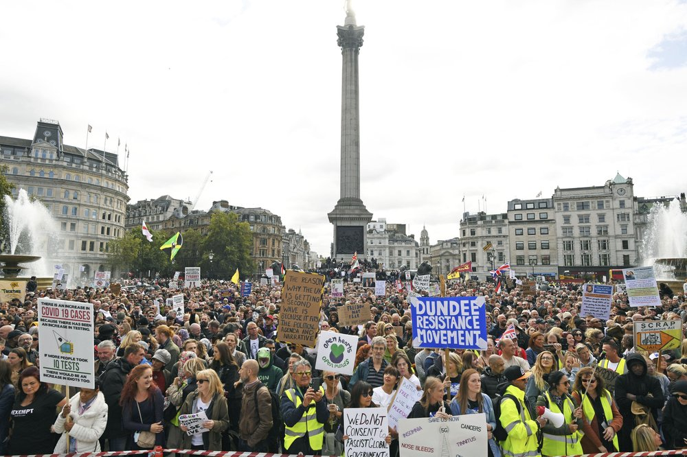 People take part in a 'We Do Not Consent' rally at Trafalgar Square, organised by Stop New Normal, to protest against coronavirus restrictions, in London, Saturday, Sept. 26, 2020. (Stefan Rousseau/PA via AP)