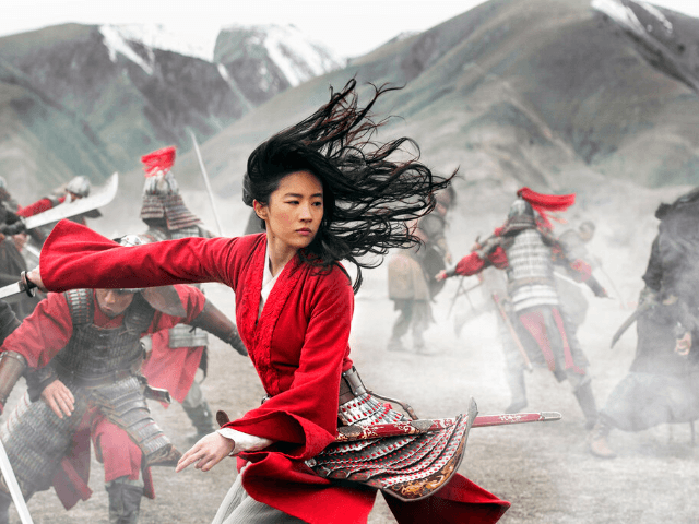 "This image released by Disney shows Yifei Liu in the title role of ""Mulan."" (Jasin Boland/Disney via AP)"