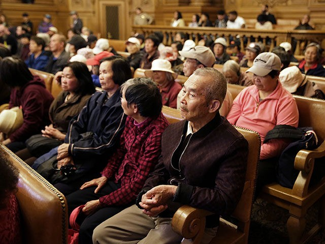 People listen during a Board of Supervisors meeting about the location of recreational cannabis stores at City Hall, Monday, Nov. 13, 2017, in San Francisco. The path toward legalizing recreational cannabis in weed-friendly San Francisco has taken a surprisingly contentious turn as critics, who are largely older Chinese American immigrants …