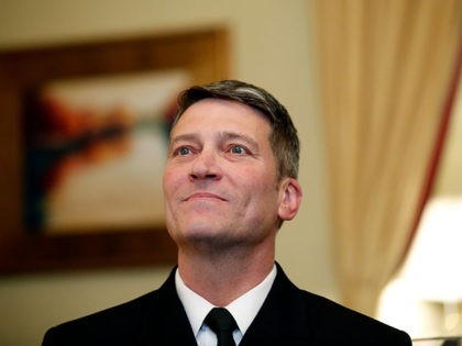 In this April 16, 2018, photo, U.S. Navy Rear Adm. Ronny Jackson, M.D., sits with Sen. Johnny Isakson, R-Ga., chairman of the Veteran's Affairs Committee, before their meeting on Capitol Hilin Washington. Jackson is President Donald Trump's nominee to be the next Secretary of Veterans Affairs. Now it's Washington's turn …