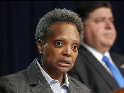 Chicago mayor Lori Lightfoot, left, speaks after Illinois Gov. J.B. Pritzker announced a shelter in place order to combat the spread of the Covid-19 virus, during a news conference Friday, March 20, 2020, in Chicago. (AP Photo/Charles Rex Arbogast)