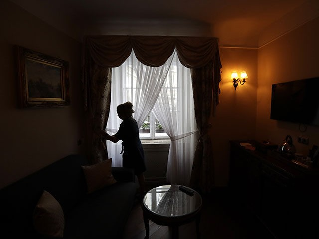 A housekeeper prepares a room for customers at a hotel in Prague, Czech Republic, Monday, May 25, 2020. The bars, restaurants and cafes are returning to full service in the Czech Republic as the government is taking further steps to ease its restrictive measures adopted to contain the coronavirus pandemic. …