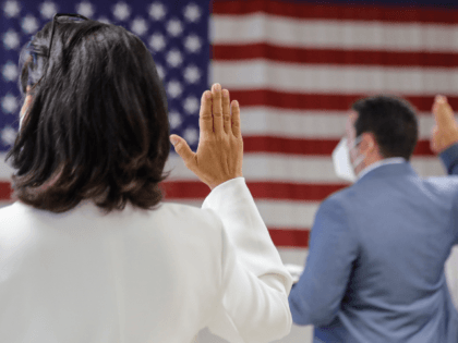 People take the oath of citizenship during a naturalization ceremony at U.S. Citizenship and Immigration Service's Field Office, Thursday, July 2, 2020, in New York. (AP Photo/Frank Franklin II)