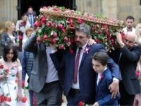MANCHESTER, ENGLAND - JULY 26: Andrew Roussos, the father of Saffie Roussos (C) holds his son Xander Roussos whilst carrying the coffin of his daughter following the funeral of the young Manchester Attack victim at Manchester Cathedral on July 26, 2017 in Manchester, England. Saffie Rousso, aged eight, from Lancashire …