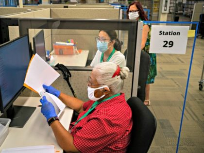 RENTON, WA - AUGUST 04: Elections workers audit military and overseas ballots at the King County Elections headquarters on August 4, 2020 in Renton, Washington. Today is election day for the primary in Washington state, where voting is done almost exclusively by mail. (Photo by David Ryder/Getty Images)