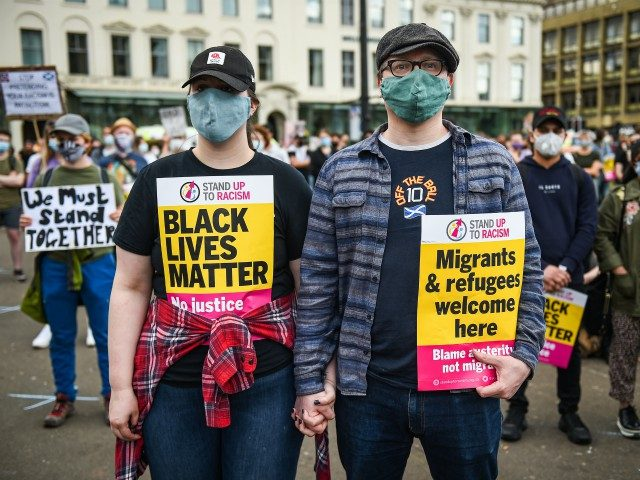 GLASGOW, UNITED KINGDOM - JUNE 20: People participate in a Black Lives Matter demonstration in George Square on June 20, 2020 in Glasgow, Scotland. Black Lives Matter protests are continuing across the UK following the death of African American George Floyd at the hands of police officers in Minneapolis on ...