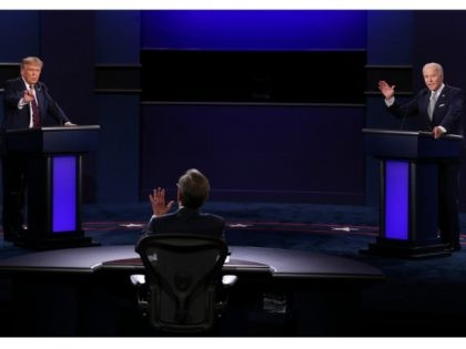 CLEVELAND, OHIO - SEPTEMBER 29: U.S. President Donald Trump and Democratic presidential nominee Joe Biden participate in the first presidential debate moderated by Fox News anchor Chris Wallace (C) at the Health Education Campus of Case Western Reserve University on September 29, 2020 in Cleveland, Ohio. This is the first …