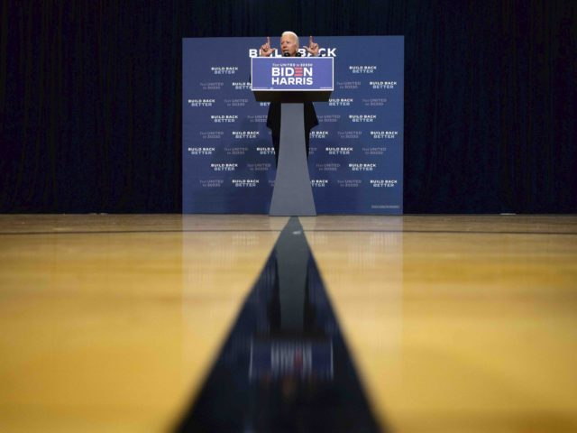 Biden press divide (Jim Watson / AFP / Getty)