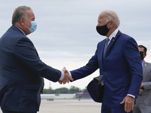 Biden shaking hands (Carolyn Kaster / Associated Press)