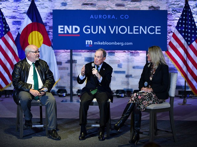 AURORA, CO - DECEMBER 05: Democratic presidential candidate, former New York City Mayor Michael Bloomberg (C) sits with Colorado state representative Tom Sullivan (L) and moderator and Everytown for Gun Safety senior managing director Debbie Weir during an event to introduce Bloomberg's gun safety policy agenda at the Heritage Christian …