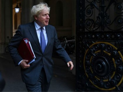Britain's Prime Minister Boris Johnson returns to Downing Street following a cabinet meeting at the Foreign and Commonwealth office on September 15, 2020. (Photo by DANIEL LEAL-OLIVAS / AFP) (Photo by DANIEL LEAL-OLIVAS/AFP via Getty Images)