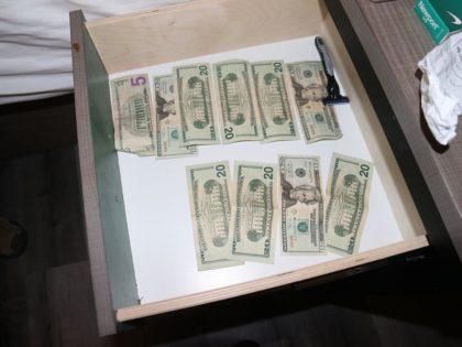Cash box found by detectives in alleged sex-trafficking hotel room. (Photo: U.S. Attorney for the Northern District of Texas)