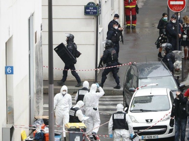 Police at the scene of a knife attack near the former offices of satirical newspaper Charlie Hebdo, Friday Sept. 25, 2020 in Paris. Paris police say they have arrested a man suspected of a knife attack that wounded at least two people near the former offices of satirical newspaper Charlie …