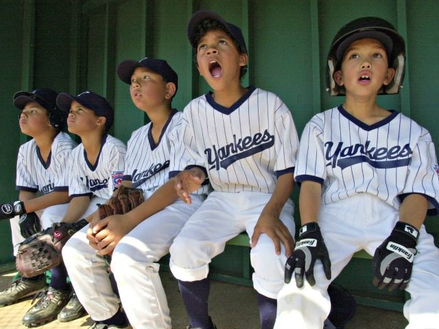 During a Little League baseball game Yankees players from right, Taylor Torrence, Jason Dunn, Brandon Henry, Jonathan Dunn and Ricardo Ramirez react to a hit made by a teammate while watching from the dugout Saturday, March 30, 2002, in Suisun City, Calif. Little League teams in the city used to …