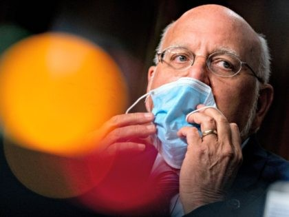 WASHINGTON, DC - SEPTEMBER 16: Centers for Disease Control and Prevention (CDC) Director Dr. Robert Redfield puts his mask on after speaking at a hearing of the Senate Appropriations subcommittee reviewing coronavirus response efforts on September 16, 2020 in Washington, DC. (Photo by Andrew Harnik-Pool/Getty Images)