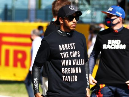 SCARPERIA, ITALY - SEPTEMBER 13: Lewis Hamilton of Great Britain and Mercedes GP stands on the grid wearing a shirt in tribute to the late Breonna Taylor before the F1 Grand Prix of Tuscany at Mugello Circuit on September 13, 2020 in Scarperia, Italy. (Photo by Mark Thompson/Getty Images)