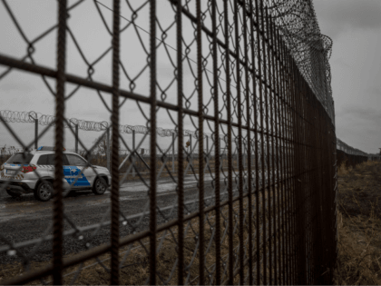 BUDAPEST, HUNGARY - JANUARY 18: Police patrol the Hungarian border fence with Serbia on January 18, 2019 outside Szeged, Hungary. In 2015 thousands of migrants massed on the Hungarian border. The situation pushed Prime Minister Vicktor Orban's government to build a fence along it's borders with Serbia, the resulting thirteen-foot-tall …