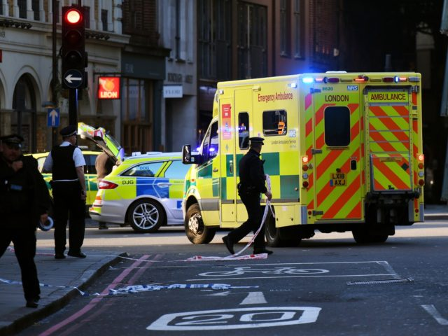 LONDON, ENGLAND - NOVEMBER 29: An ambulance is let through a police cordon near Borough Market after a number of people are believed to have been injured after a stabbing at London Bridge, police have said, on November 29, 2019 in London, England. Police said they were called to the …