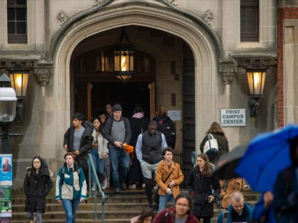 PRINCETON, NJ - FEBRUARY 04: Students exit a building between classes at Princeton University on February 4, 2020 in Princeton, New Jersey. The university said over 100 students, faculty, and staff who recently traveled to China must 'self-isolate' themselves for 14 days to contain any possible exposure to the novel …