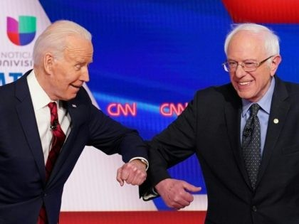 TOPSHOT - Democratic presidential hopefuls former US vice president Joe Biden (L) and Senator Bernie Sanders greet each other with a safe elbow bump before the start of the 11th Democratic Party 2020 presidential debate in a CNN Washington Bureau studio in Washington, DC on March 15, 2020. (Photo by …