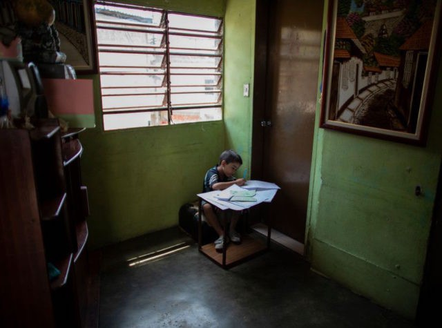 CARACAS, VENEZUELA - APRIL 28: Fourth grade Carlos Alayon does the schoolwork at home during the second month of quarantine in the Country on April 28, 2020 in Caracas, Venezuela. Due to the government-ordered coronavirus lockdown, students in Venezuela will have to attend classes remotely until the end of the …