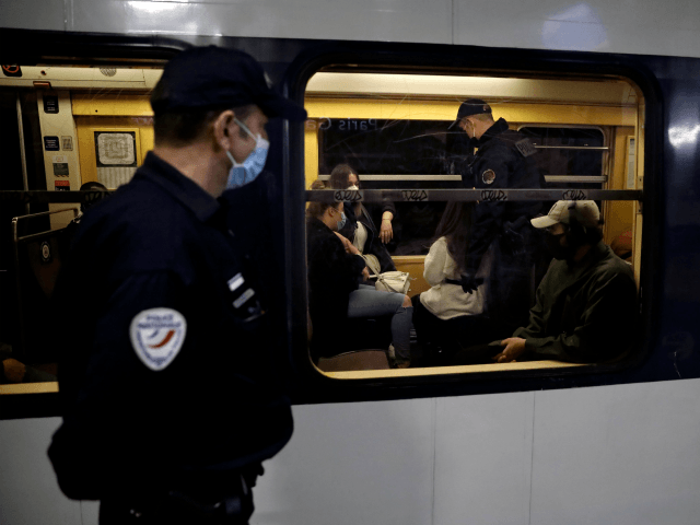 French police officers patrol and control Regional Express Network's (Reseau Express Regional) commuters at the Paris' Gare du Nord station during rush hour in Paris on May 15, 2020, as France eases lockdown measures taken to curb the spread of the COVID-19 (the novel coronavirus). - Police officers control if …