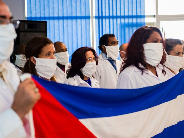 A delegation of Cuban doctors attend a welcoming event after their arrival at the Martinique-Aime-Cesaire airport in Le Lamentin, near Fort-de-France, on the French Caribbean island of Martinique on June 26, 2020, as part of a medical assistance programme amid the COVID-19 pandemic, caused by the novel coronavirus. - A …