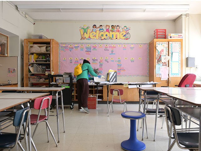 NEW YORK, NEW YORK - MAY 14: A teacher collects supplies needed to continue remote teaching through the end of the school year at Yung Wing School P.S. 124 on May 14, 2020 in New York City. In April, it was announced that NYC public schools would be closed at …
